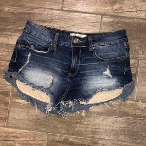 Dark wash jean shorts w/ shiny lace pockets